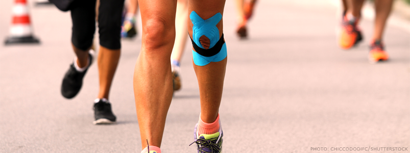 Runner with a taped knee